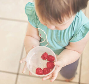 child with bowl of berries