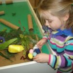 Child playing with craft supplies