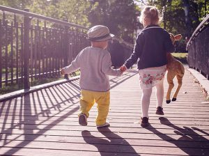 children walking on bridge