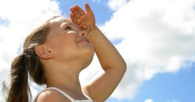 child watching clouds