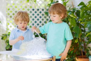 two boys with bubbles