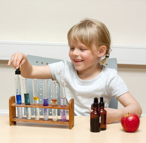 child with test tubes