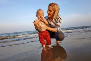 mom and toddler at the beach