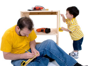 dad and son working with tools