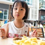 How Do Family Mealtimes and Other Daily Routines Enhance a Child's Well-Being?