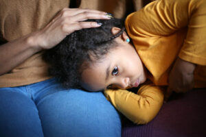 child comforted by parent