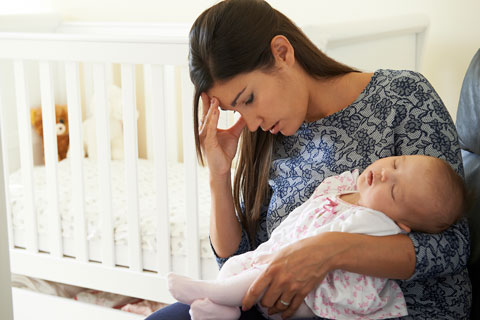 mother holding infant