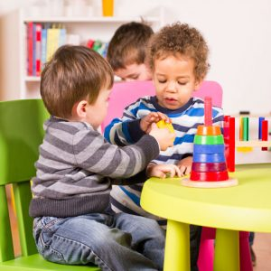 chldren playing at table
