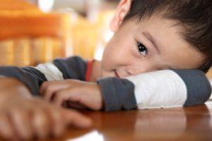 small boy resting on arm