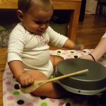 child using a drum