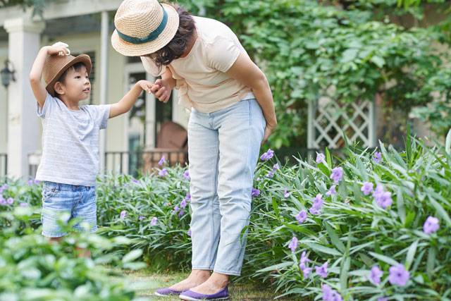 child with mother in garden
