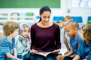 teacher reading book to children