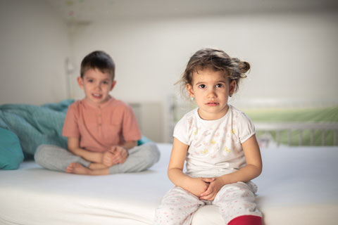 girl and boy on bed