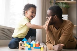dad and child playing with blocks
