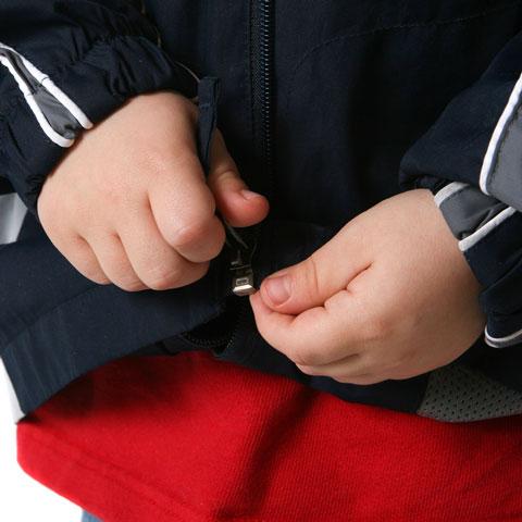 child zipping coat