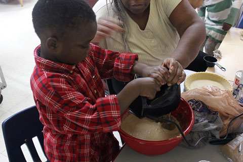 Figure 3. Children used tools for baking, with assistance.