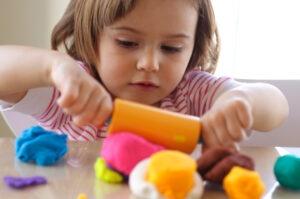 girl with playdough