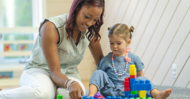 mother and child playing with blocks