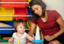 adult and child in playroom